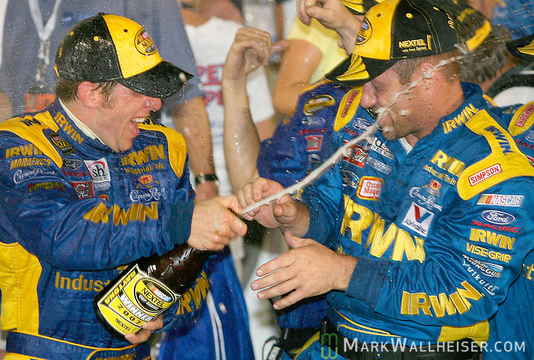 Jamie McMurray , left, sprays champagne as he celebrates in victory lane after he drove his number 26 Ford to win the Pepsi 400 NASCAR Nextel Cup Series race at the Daytona International Speedway in Daytona Beach, Florida July 7, 2007.       (Mark Wallheiser/TallahasseeStock.com)