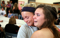 Nurse Amanda Bigley, left, and Elizabeth shed tears while saying goodbye to each other during a farewell party for Elizabeth at On With Life, a brain injury rehabilitation center.