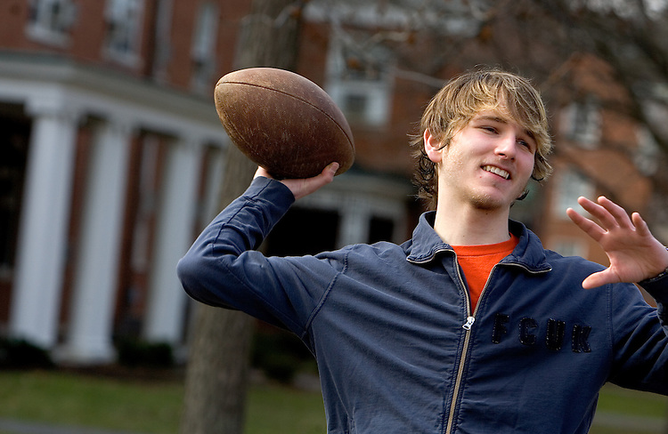 Kevin Wheeler plays football with friends on campus on Wednesday, 2/28/07.
