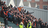 Blackpool fans celebrate their sides win<br /> <br /> Photographer Kevin Barnes/CameraSport<br /> <br /> The EFL Sky Bet League Two - Saturday 18th March 2017 - Newport County v Blackpool - Rodney Parade - Newport<br /> <br /> World Copyright &copy; 2017 CameraSport. All rights reserved. 43 Linden Ave. Countesthorpe. Leicester. England. LE8 5PG - Tel: +44 (0) 116 277 4147 - admin@camerasport.com - www.camerasport.com