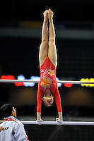 02/20/09 - Photo by John Cheng for USA Gymnastics.  Japanese gymnast Yu Minobe performs on uneven bars in a meet against US before the Tyson American Cup at Sears Centre Arena in Chicago.