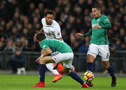 25th November 2017, Wembley Stadium, London England; EPL Premier League football, Tottenham Hotspur versus West Bromwich Albion; Mousa Dembele of Tottenham Hotspur passing the ball passed Jake Livermore of West Bromwich Albion and Claudio Yacob of West Bromwich Albion