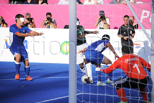 08.09.2012 London, England. Riverbank Arena. 5 a side Blind Football, Bronze match play-off. Severino Gabriel da SILVA forces his way through a packed defence to score the second goal for Brazil in the Final against France.
