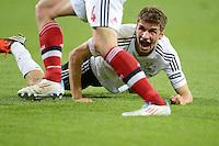 FUSSBALL  EUROPAMEISTERSCHAFT 2012   VORRUNDE Daenemark - Deutschland       17.06.2012 Thomas Mueller (Deutschland) am Boden