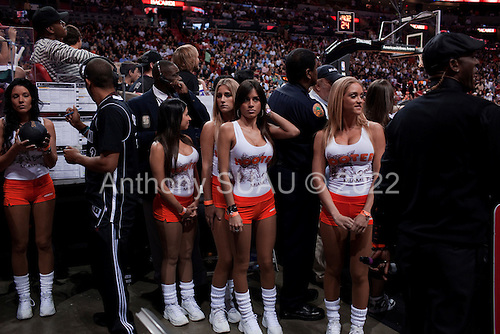 Miami, Florida<br /> January 29, 2012<br /> <br /> Hooters girls prepare to take the court as the Miami HEAT and the Chicago BULLS call a time out.