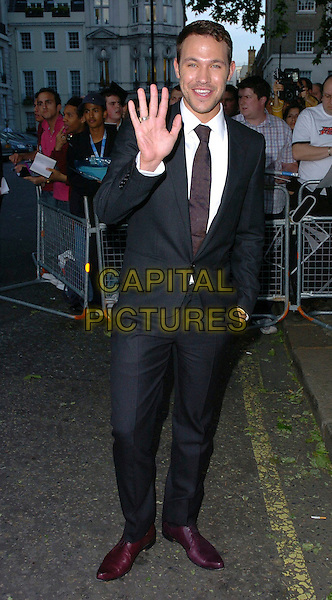 WILL YOUNG.Glamour magazine's 3rd Annual Woman of the Year Awards Berkeley Square Gardens - Arrivals, London, UK. .June 6th, 2006 .Ref: CAN.full length black suit hand in pockets purple shoes palm waving.www.capitalpictures.com.sales@capitalpictures.com.©Capital Pictures