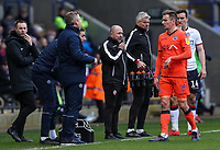 Bolton Wanderers' assistant manager Steve Parkin takes instructions by radio from manager Phil Parkinson <br /> <br /> Photographer Andrew Kearns/CameraSport<br /> <br /> The EFL Sky Bet Championship - Bolton Wanderers v Millwall - Saturday 9th March 2019 - University of Bolton Stadium - Bolton <br /> <br /> World Copyright © 2019 CameraSport. All rights reserved. 43 Linden Ave. Countesthorpe. Leicester. England. LE8 5PG - Tel: +44 (0) 116 277 4147 - admin@camerasport.com - www.camerasport.com
