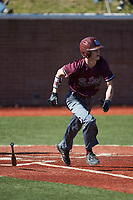 Ryan Fralin (28) of the Concord Mountain Lions starts down the first base line against the Wingate Bulldogs at Ron Christopher Stadium on February 2, 2020 in Wingate, North Carolina. The Mountain Lions defeated the Bulldogs 12-11. (Brian Westerholt/Four Seam Images)