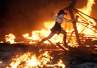 BLACK ROCK CITY,NV - AUGUST 30, 2008: Participants run around what is left of the the Man. after a closing ceremony including pyrotechnics and fire dancing. The finale of the Burning Man event, August 30, 2008. The annual arts festival attracts over 30,000 participants to the Nevada desert each year.