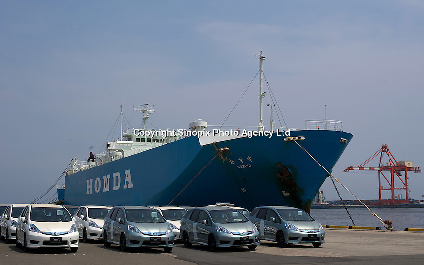 Honda cars are lined up at Sendai Port, Miyagi Prefecture, Japan.  Honda plans to get back to near full production but expect a massive decrease in profit due to the tsunami and the continued strength of the yen..13 Jun 2011.....