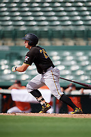 Pittsburgh Pirates first baseman Mason Martin (25) follows through on a swing during a Florida Instructional League game against the Baltimore Orioles on September 22, 2018 at Ed Smith Stadium in Sarasota, Florida.  (Mike Janes/Four Seam Images)