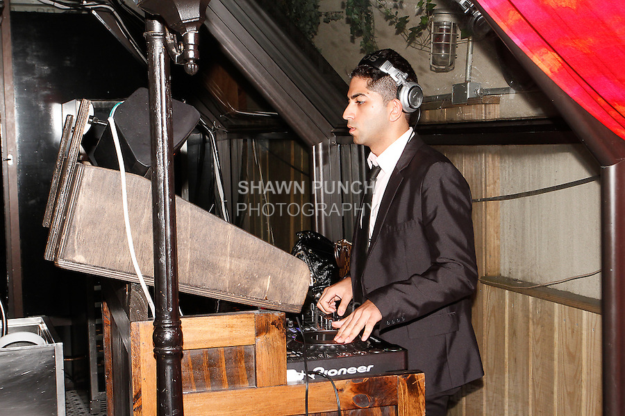 Hareesh Bajaj of HR Beats, plays music during the Sheena Trivedi Spring Summer 2014 collection fashion show, at Hotel Chantelle on October 21, 2013.