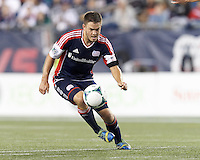 New England Revolution midfielder Kelyn Rowe (11) collects a pass.  In a Major League Soccer (MLS) match, the New England Revolution (blue) defeated D.C. United (white), 2-1, at Gillette Stadium on September 21, 2013.