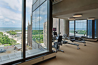 The fitness facility at  the Uniiversity Club of Chicago with a wonderful view onto Lake Michigan, Michigan Avenue and the modern wing of the Art Institute.