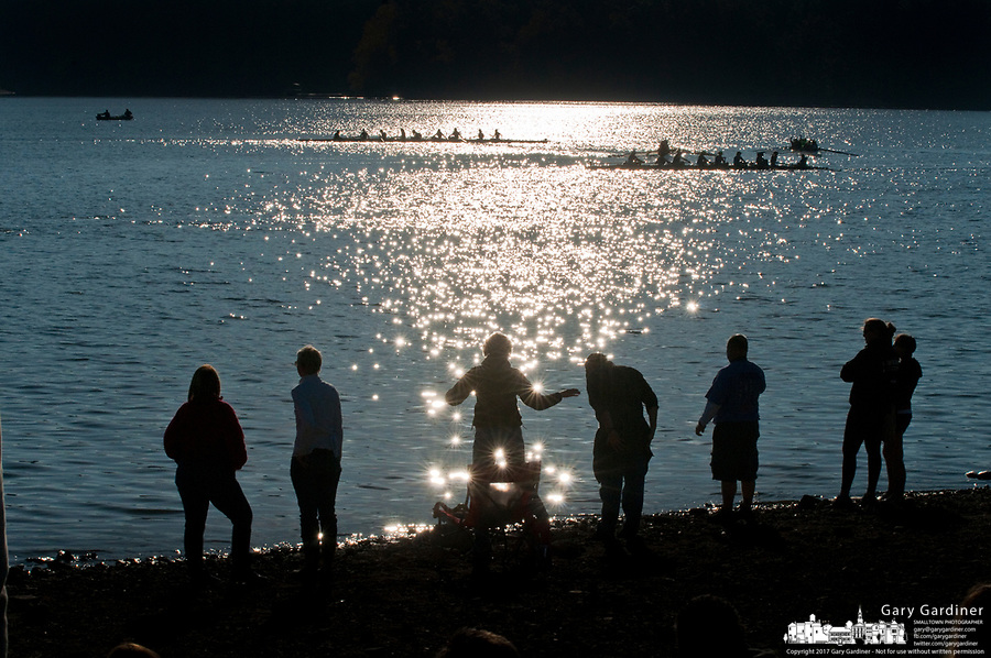Families and fans line the edge of Hoover Reservoir for during early morning competition at the Fall Classic. The annual rowing competition is sponsored by the Westerville Rowing Club.