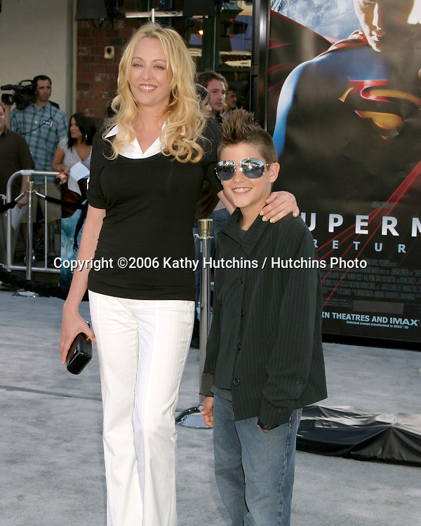 "Virginia Madsen and son Jack.""Superman Returns"" Premiere.Mann's Village Theater.Westwood, CA.June 21, 2006.©2006 Kathy Hutchins / Hutchins Photo...."