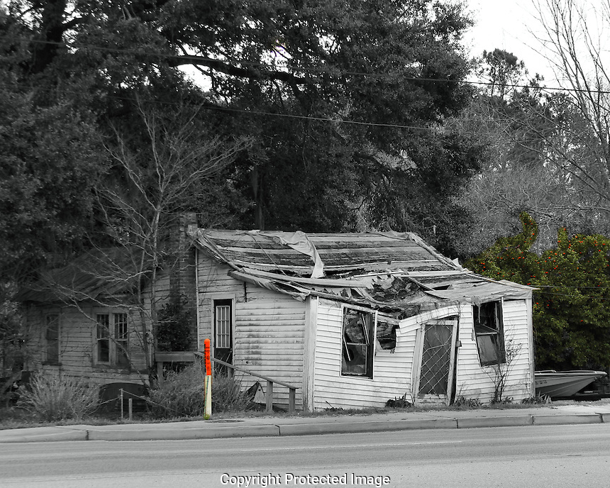The owners of this home moved into a neaby building that appears to also be structurally unsound. Lots of poverty in South Carolian; folks do not always have the financial means of maintaining a home and will often abandon the property when it's on the verge of collapse.