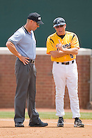 VCU Rams head coach Paul Keyes #5 discusses a call with first base umpire Rick Scarbery at the Charlottesville Regional of the 2010 College World Series at Davenport Field on June 5, 2010, in Charlottesville, Virginia.  The Red Storm defeated the Rams 8-6.  Photo by Brian Westerholt / Four Seam Images