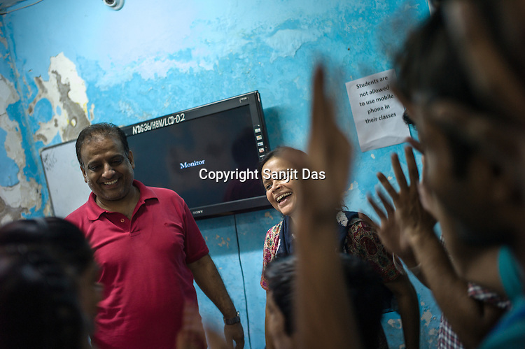 Runa Roka (54), founder of the Noida Deaf Society interacts with her students at the foundation in NOIDA, India.