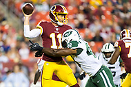 Landover, MD - August 16, 2018: Washington Redskins quarterback Alex Smith (11) is pressured by New York Jets linebacker Jordan Jenkins (48) during preseason game between the New York Jets and Washington Redskins at FedEx Field in Landover, MD. (Photo by Phillip Peters/Media Images International)