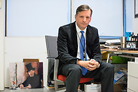 "Anthony Amore is the Directory of Security and Chief Investigator at the Isabella Stewart Gardner Museum in Boston, Mass., USA, seen here in his office on Tues., Dec. 5, 2017. Part of Amore's ongoing work is the investigation into the 1990 theft of 13 pieces from the museum: 10 paintings, 2 objects, and 1 etching. Among the paintings stolen were works by Rembrandt, Vermeer, Degas, and Manet. At left, on the ground, is a reproduction of Manet's ""Chez Tortoni."" The painting is one of those stolen in the heist."