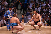 Bulgarian Kotooshu (Kaloyan Stefanov Mahlyanov; right, black mawashi) ahead of a bout with Estonian Baruto (Kaido Höövelson; left, blue mawashi) in the controversial Nagoya summer Grand Sumo Tournament held on the 14th and second final day.