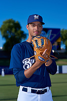 AZL Brewers Blue Antoine Kelly (14) poses for a photo before an Arizona League game against the AZL Athletics Gold on July 2, 2019 at American Family Fields of Phoenix in Phoenix, Arizona. AZL Athletics Gold defeated the AZL Brewers Blue 11-8. (Zachary Lucy/Four Seam Images)