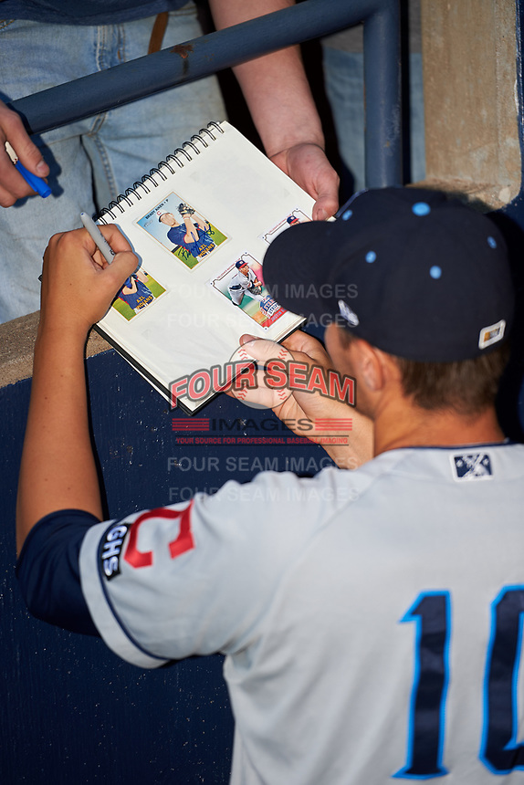 Lake County Captains pitcher Brady Aiken (10) signs autographs for fans before a game against the Quad Cities River Bandits on May 6, 2017 at Modern Woodmen Park in Davenport, Iowa.  Lake County defeated Quad Cities 13-3.  (Mike Janes/Four Seam Images)