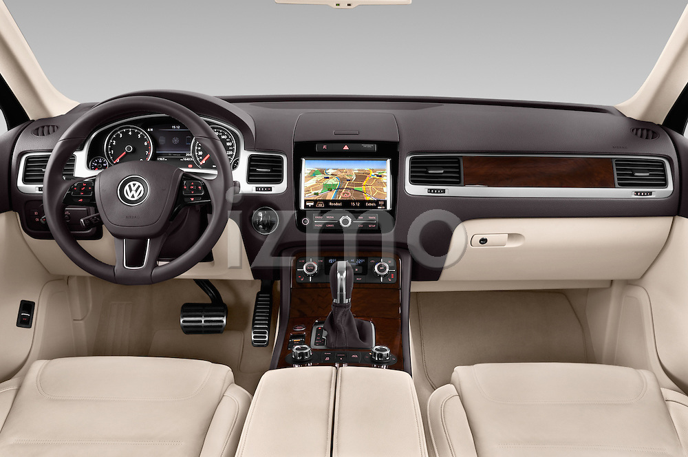 Stock photo of straight dashboard view of a 2014 Volkswagen Touareg Hybrid 5 Door SUV 2WD Dashboard