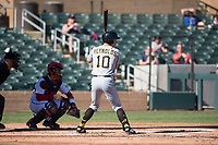 Surprise Saguaros left fielder Bryan Reynolds (10), of the Pittsburgh Pirates organization, at bat in front of catcher Tres Barrera (12) and home plate umpire Junior Valentine during an Arizona Fall League game against the Salt River Rafters at Salt River Fields at Talking Stick on November 5, 2018 in Scottsdale, Arizona. Salt River defeated Surprise 4-3 . (Zachary Lucy/Four Seam Images)