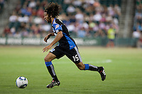 Justin Morrow dribbles the ball. The San Jose Earthquakes defeated Chivas USA 6-5 in shootout after drawing 0-0 in regulation time to win the inagural Sacramento Cup at Raley Field in Sacramento, California on June 12, 2010.