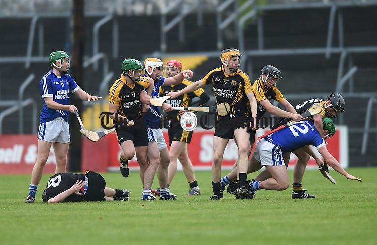 Cratloe and Ballyea players do a bit of wrestling during their match in Ennis. Photograph by John Kelly.