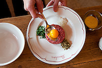 Preparation of steak tartare at Bouchon restaurant, Monaco, 23 March 2012. Raw ingredients are presented to each customer at their table and the steak tartare is mixed according to their preferences in front of them.