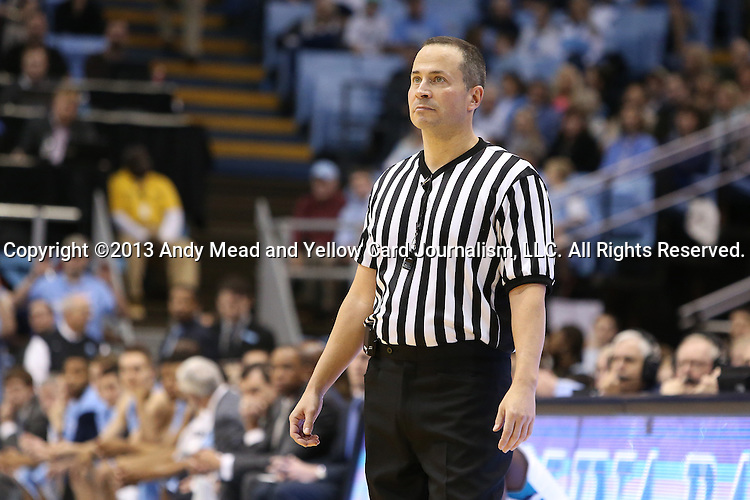 31 December 2013: Referee Jeff Nichols. The University of North Carolina Tar Heels played the UNC Wilmington Seahawks at the Dean E. Smith Center in Chapel Hill, North Carolina in a 2013-14 NCAA Division I Men's Basketball game. UNC won the game 84-51.