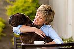 Mature woman hugging dog