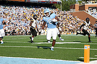 CHAPEL HILL, NC - SEPTEMBER 21: Michael Carter #8 of the University of North Carolina runs the ball into the end zone for a touchdown during a game between Appalachian State University and University of North Carolina at Kenan Memorial Stadium on September 21, 2019 in Chapel Hill, North Carolina.