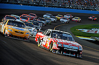 Nov. 9, 2008; Avondale, AZ, USA; NASCAR Sprint Cup Series driver Carl Edwards (99) leads a pack of cars during the Checker Auto Parts 500 at Phoenix International Raceway. Mandatory Credit: Mark J. Rebilas-