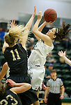 SPEARFISH, SD - FEBRUARY 4, 2017 -- Haley Schnieder #32 of  Black Hills State shoots over  Tori Fisher #11 of UCCS during their Rocky Mountain Athletic Conference game Saturday at the Donald E. Young Center in Spearfish, S.D.  (Photo by Dick Carlson/Inertia)