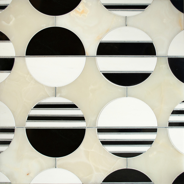 Lya, a waterjet stone mosaic, shown in honed White Onyx, Dolomite, polished Nero Marquina, with Zinc liners, is part of the Bright Young Things™ collection by New Ravenna.