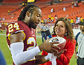 Washington Redskins cornerback Josh Norman (24) is interviewed by NBC sideline reporter Michele Tafoya following the game against the Oakland Raiders at FedEx Field in Landover, Maryland on Sunday, September 24, 2017.  The Redskins won the game 27-10.<br /> Credit: Ron Sachs / CNP