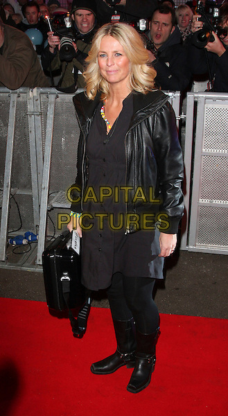 ULRIKA JONSSON .Celebrity Big Brother housemates enter The House Elstree Studios, Borehamwood, Hertfordshire (Herts), England, 2nd January 2009..full length black leather jacket trousers bag leggings boots tights dress biker buttons Johnson jonson .CAP/ROS.©Steve Ross/Capital Pictures