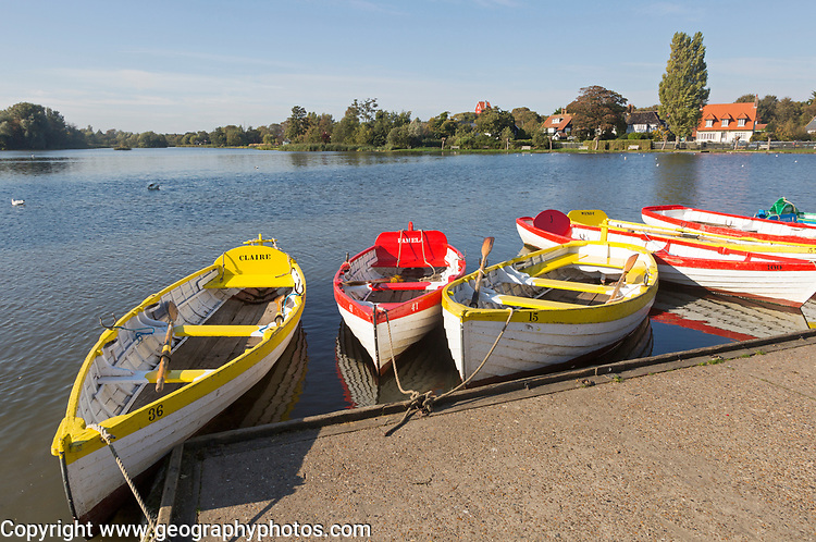 Colourful rowing boats on the Meare boating pond, Thorpeness, Suffolk, England, UK