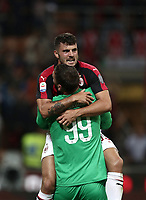 Calcio, Serie A: AC Milan - AS Roma, Milano stadio Giuseppe Meazza (San Siro) 31 agosto 2018. <br /> AC Milan's goalkeeper Gianluigi Donnarumma (bottom) celebrates with his teammates Patrick Cutrone (top) after winning 2-1 the Italian Serie A football match between Milan and Roma at Giuseppe Meazza stadium, August 31, 2018. <br /> UPDATE IMAGES PRESS/Isabella Bonotto