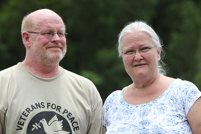 U.S. veteran Chris Jaminson and spouse Signe Nelson at a spot on Highway 9, near the former Demilitarized Zone, in Vietnam where Jaminson served in 1970 during the war. Jaminson and Nelson toured  Vietnam with Veterans for Peace, learning about efforts to mitigate the suffering of the country's Agent Orange victims and those who have been maimed by land mines and bombs left over from the war. April 24, 2013.
