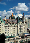Copper roofing on Chateau Laurier Hotel, Ottawa, Canada showing several stages of weathering