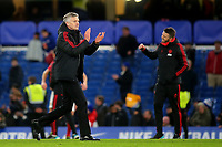 Manchester United Caretaker Manager, Ole Gunnar Solskjaer applauds the away fans at the end of the match as Michael Carrick celebrates in the background during Chelsea vs Manchester United, Emirates FA Cup Football at Stamford Bridge on 18th February 2019