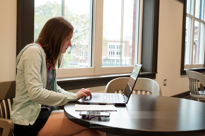 Old Main Academic Center - first day of classes.  Students in between classes: Civil Engineering major Allison Tetrick with laptop at lounge area.<br />  (photo by Megan Bean / &copy; Mississippi State University)