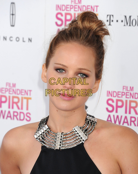 Jennifer Lawrence.2013 Film Independent Spirit Awards - Arrivals Held At Santa Monica Beach, Santa Monica, California, USA,.23rd February 2013..indy indie indies indys portrait headshot hair up bun silver black collar halterneck .CAP/ROT/TM.© TM/Roth/Capital Pictures