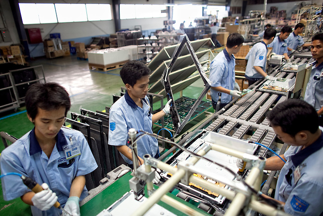 Sumsung employees assemble LCD television sets at the Samsung Vina Electronics Co. factory in district Thu Duc in Ho Chi Minh City, Vietnam. Photo taken on Friday, December 4, 2009. Kevin German / Luceo Images