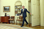 Washington, D.C. - May 8, 2006 -- United States President George W. Bush arrives enters the Oval Office of the White House to name Air Force General Michael Hayden to be the next Central Intelligence Agency (CIA) Director on May 8, 2006. Hayden will replace Porter Goss if confirmed.  <br /> Credit: Roger Wollenberg - Pool via CNP